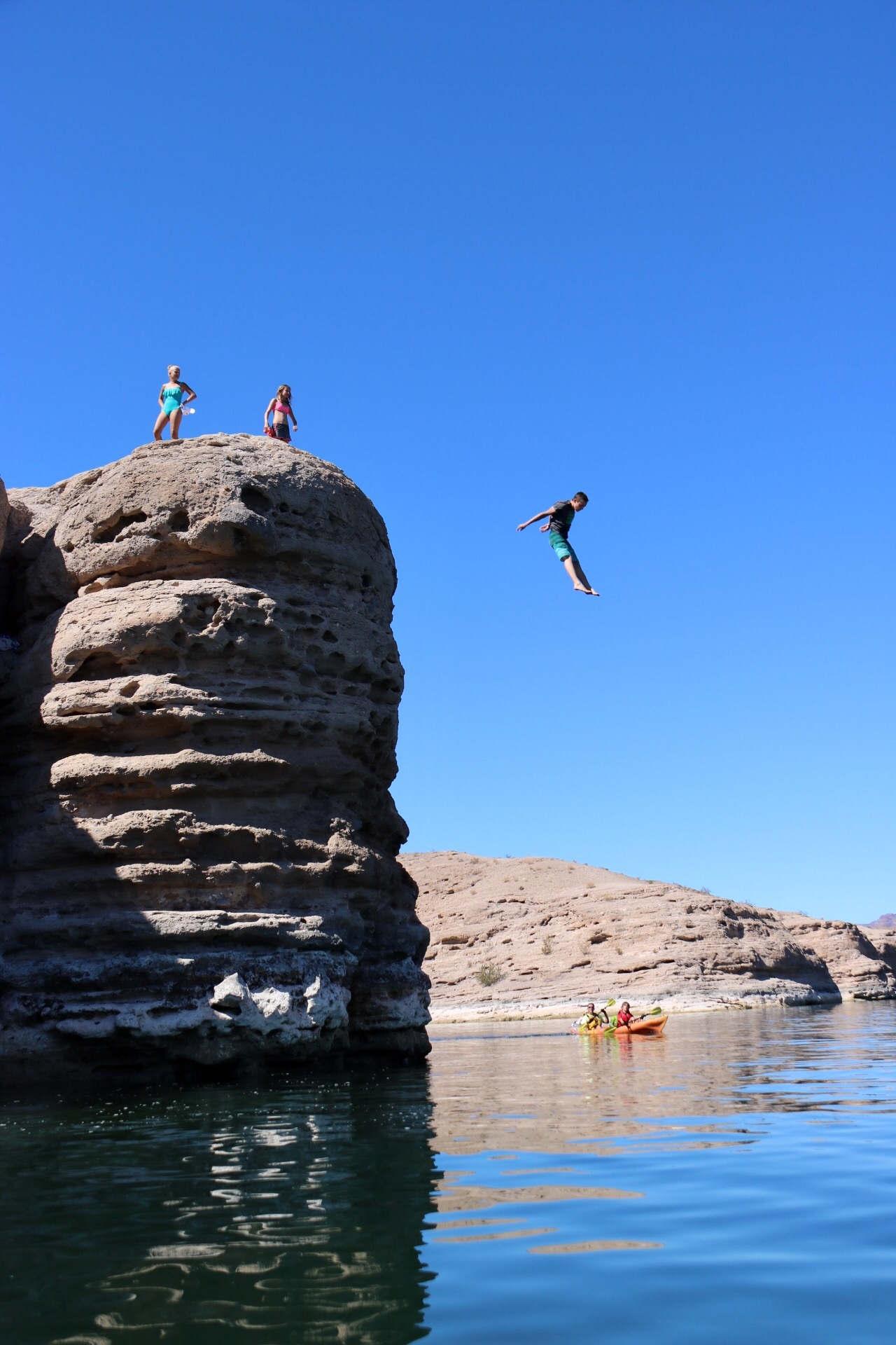 Cliff jumping at Nelson's Landing: Kayak the Colorado River